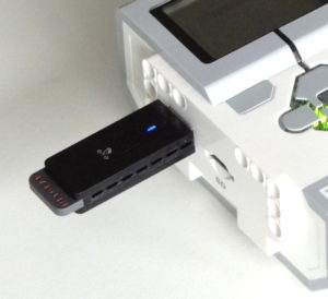 EV3 Brick with Netgear WNA 1100 WiFi dongle. This configuration provides an alternative to USB or Bluetooth when programming the EV3.
